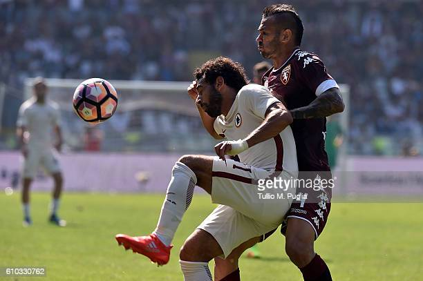 Mohamed Salah of Roma and Leandro Castan of Torino compete for the ball during the Serie A match between FC Torino and AS Roma at Stadio Olimpico di...