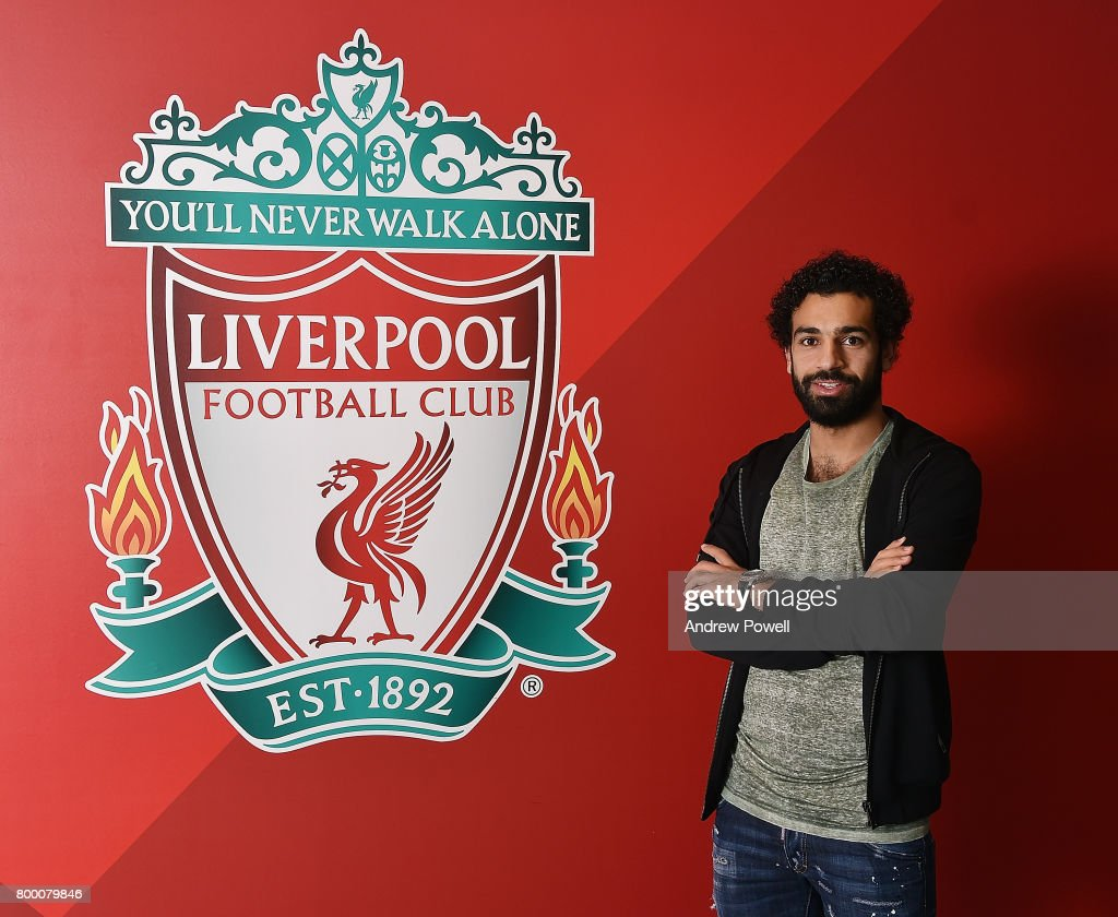 Mohamed Salah poses after new signing for Liverpool at Anfield on June 23, 2017 in Liverpool, England.