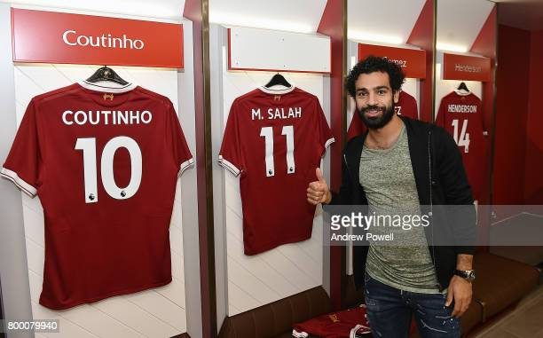 Mohamed Salah poses after new signing for Liverpool at Anfield on June 23 2017 in Liverpool England