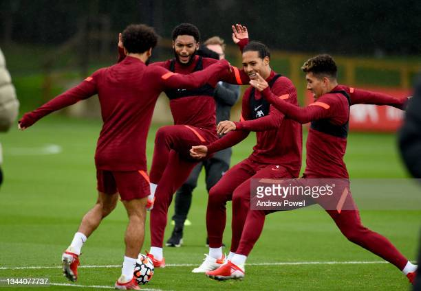 Mohamed Salah, Roberto Firmino, Virgil van Dijk and Joe Gomez of Liverpool during a training session at AXA Training Centre on September 30, 2021 in...