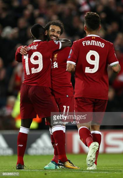 Mohamed Salah Sadio Mane and Roberto Firmino of Liverpool celebrates a goal during the UEFA Champions League Semi Final First Leg match between...