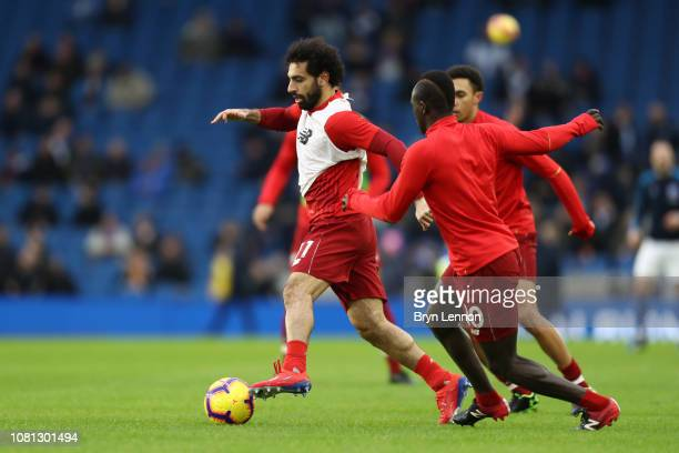 Mohamed Salah Sadio Mane and Trent AlexanderArnold of Liverpool warm up prior to the Premier League match between Brighton Hove Albion and Liverpool...