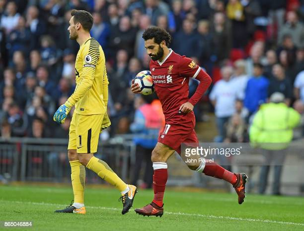Mohamed Salah scores Liverpool first and celebrates during the Premier League match between Tottenham Hotspur and Liverpool at Wembley Stadium on...