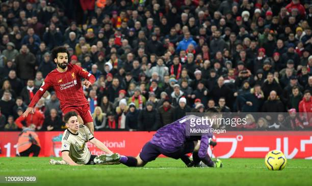 Mohamed Salah scores the 2nd goal during the Premier League match between Liverpool FC and Manchester United at Anfield on January 19, 2020 in...