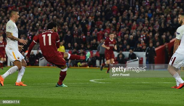 Mohamed Salah scores the first goal for Liverpool during the UEFA Champions League Semi Final First Leg match between Liverpool and AS Roma at...