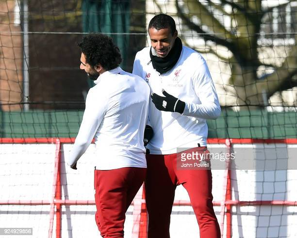 Mohamed Salah with Joel Matip of Liverpool during a training session at Melwood Training Ground on February 27 2018 in Liverpool England