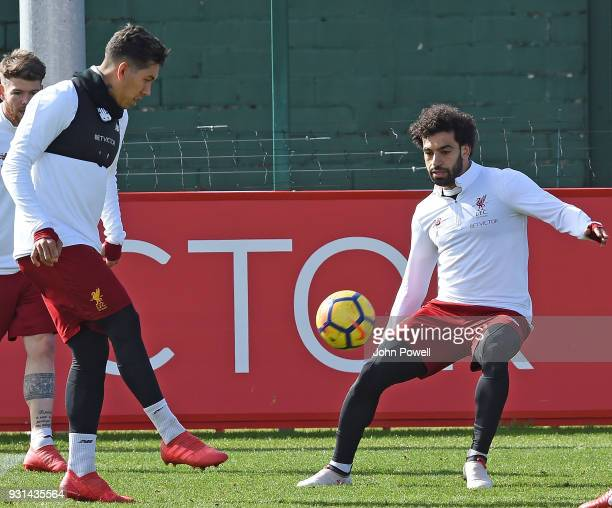 MARCH 13 Mohamed Salah with Roberto Firmino of Liverpool during a training session at Melwood Training Ground on March 13 2018 in Liverpool England