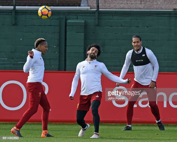 MARCH 13 Mohamed Salah with Virgil van Dijk and Nathaniel Clyne of Liverpool during a training session at Melwood Training Ground on March 13 2018 in...