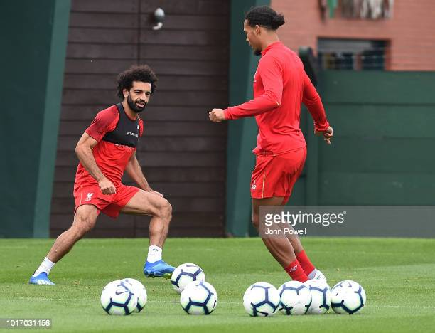 Mohamed Salah with Virgil van Dijk of Liverpool during a training session at Melwood Training Ground on August 15 2018 in Liverpool England