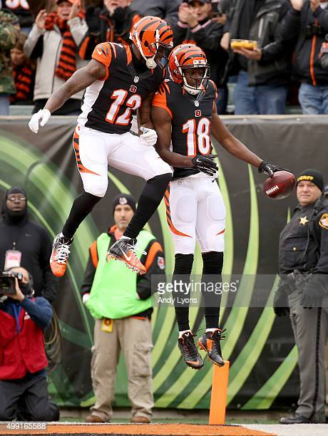 Mohamed Sanu and AJ Green of the Cincinnati Bengals celebrate after scoring a touchdown during the first quarter against the St Louis Rams at Paul...