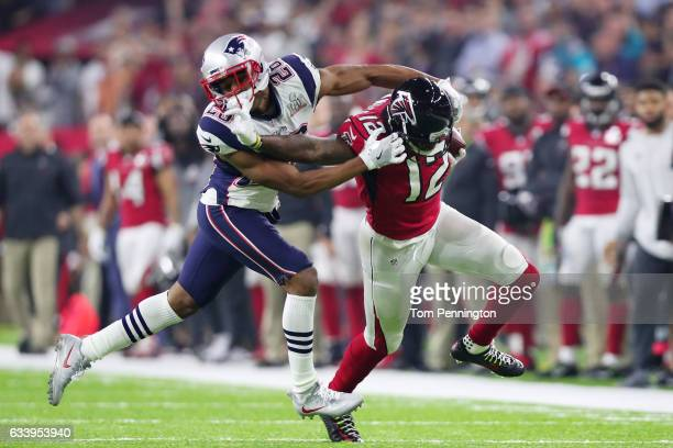 Mohamed Sanu of the Atlanta Falcons avoids a tackle by Logan Ryan of the New England Patriots in the fourth quarter during Super Bowl 51 at NRG...