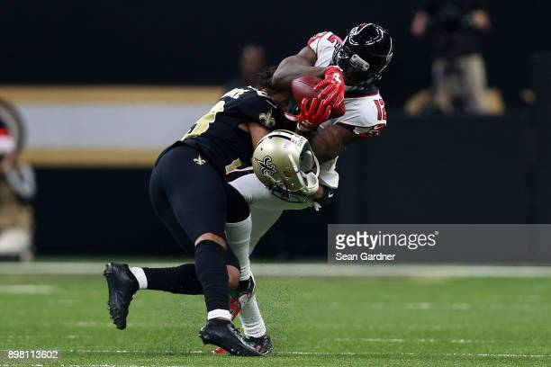 Mohamed Sanu of the Atlanta Falcons catches the ball as Marshon Lattimore of the New Orleans Saints defends during the second half of a game at the...