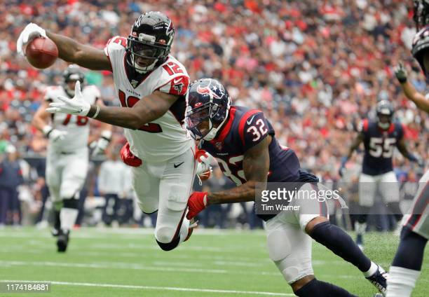 Mohamed Sanu of the Atlanta Falcons dives for a touchdown defended by Lonnie Johnson of the Houston Texans in the first quarter at NRG Stadium on...