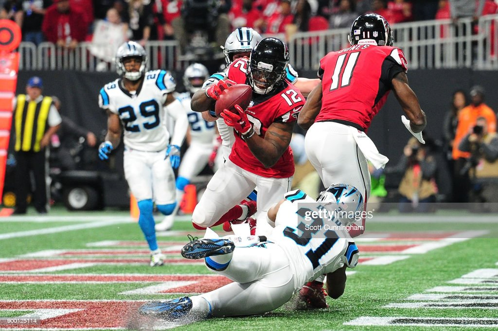 Mohamed Sanu #12 of the Atlanta Falcons fails to make a catch for a touchdown during the second half against the Carolina Panthers at Mercedes-Benz Stadium on December 31, 2017 in Atlanta, Georgia.