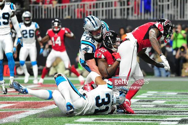 Mohamed Sanu of the Atlanta Falcons fails to make a catch for a touchdown during the second half against the Carolina Panthers at MercedesBenz...