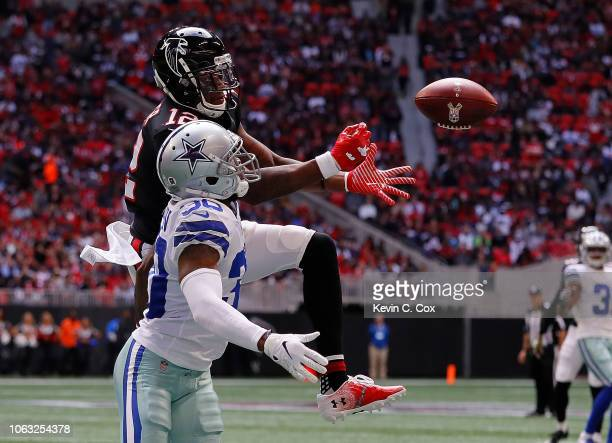 Mohamed Sanu of the Atlanta Falcons fails to pull in this reception against Anthony Brown of the Dallas Cowboys at Mercedes-Benz Stadium on November...