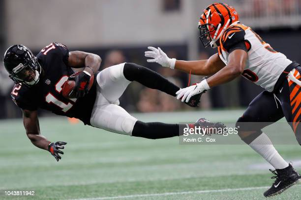 Mohamed Sanu of the Atlanta Falcons is tackled by Hardy Nickerson of the Cincinnati Bengals during the second quarter against the Cincinnati Bengals...