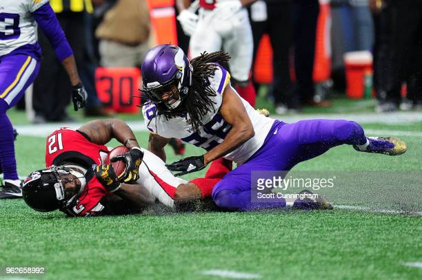 Mohamed Sanu of the Atlanta Falcons is tackled by Trae Waynes of the Minnesota Vikings at MercedesBenz Stadium on December 3 2017 in Atlanta Georgia