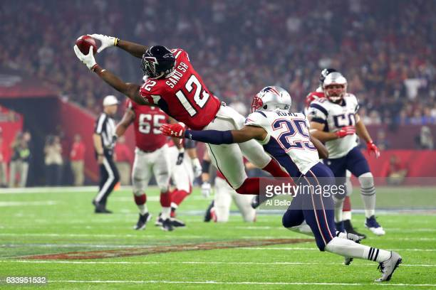 Mohamed Sanu of the Atlanta Falcons makes a catch against Eric Rowe of the New England Patriots in the third quarter during Super Bowl 51 at NRG...