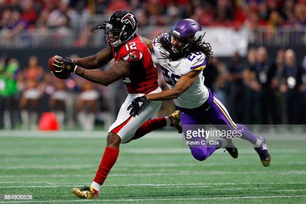 Mohamed Sanu of the Atlanta Falcons makes a catch against Trae Waynes of the Minnesota Vikings during the first half at Mercedes-Benz Stadium on...