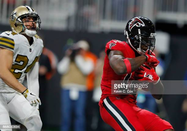 Mohamed Sanu of the Atlanta Falcons pulls in this touchdown reception against Sterling Moore of the New Orleans Saints at MercedesBenz Stadium on...
