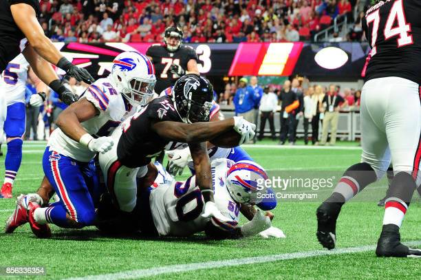 Mohamed Sanu of the Atlanta Falcons reaches for extra yardage during the first half against the Buffalo Bills at MercedesBenz Stadium on October 1...