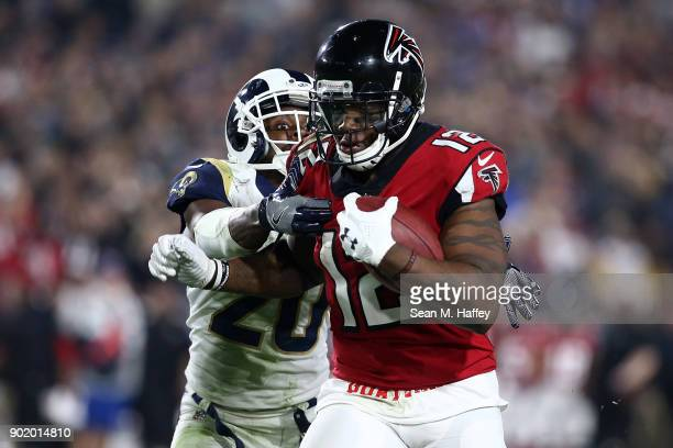 Mohamed Sanu of the Atlanta Falcons runs down field in front of Lamarcus Joyner of the Los Angeles Rams during the NFC Wild Card Playoff Game at the...