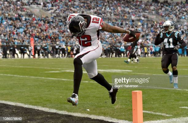 Mohamed Sanu of the Atlanta Falcons runs for a touchdown against the Carolina Panthers in the third quarter during their game at Bank of America...