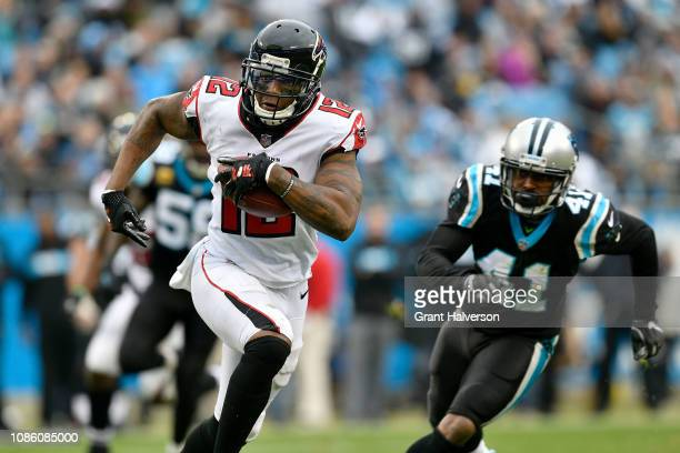 Mohamed Sanu of the Atlanta Falcons runs the ball against Captain Munnerlyn of the Carolina Panthers in the third quarter during their game at Bank...