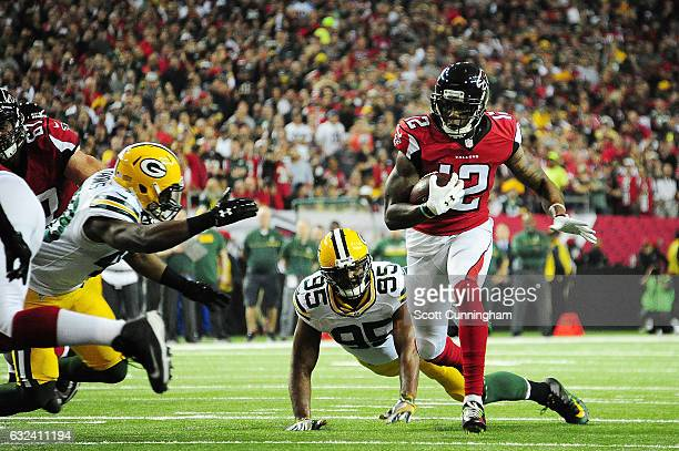 Mohamed Sanu of the Atlanta Falcons runs the ball against the Green Bay Packers during the first quarter in the NFC Championship Game at the Georgia...