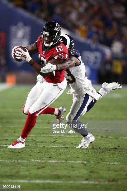 Mohamed Sanu of the Atlanta Falcons runs the ball down field in front Nickell RobeyColeman of the Los Angeles Rams of during the NFC Wild Card...