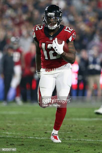 Mohamed Sanu of the Atlanta Falcons runs the ball during the NFC Wild Card Playoff Game against the Los Angeles Rams at the Los Angeles Coliseum on...