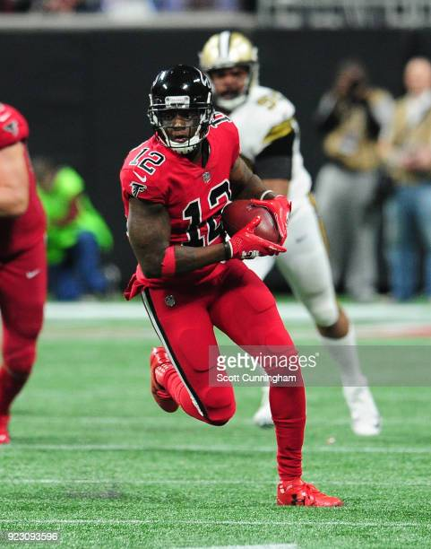 Mohamed Sanu of the Atlanta Falcons runs with a catch against the New Orleans Saints at MercedesBenz Stadium on December 7 2017 in Atlanta Georgia