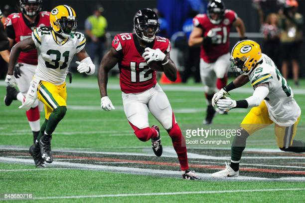 Mohamed Sanu of the Atlanta Falcons runs with the ball during the first half against the Green Bay Packers at MercedesBenz Stadium on September 17...
