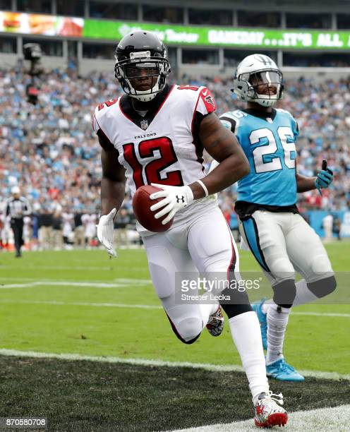 Mohamed Sanu of the Atlanta Falcons scores a touchdown against the Carolina Panthers in the first quarter during their game at Bank of America...