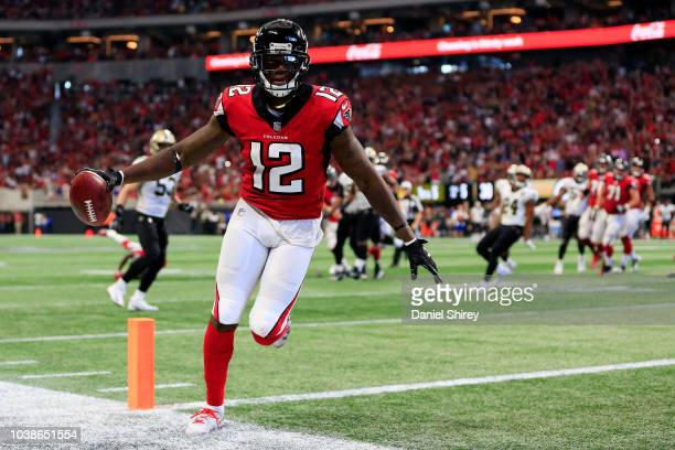 Mohamed Sanu of the Atlanta Falcons scores a touchdown during the fourth quarter against the New Orleans Saints at Mercedes-Benz Stadium on September...
