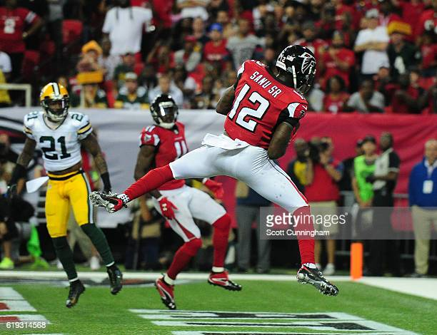 Mohamed Sanu of the Atlanta Falcons scores the gamewinning touchdown with 21 second left against the Green Bay Packers at the Georgia Dome on October...