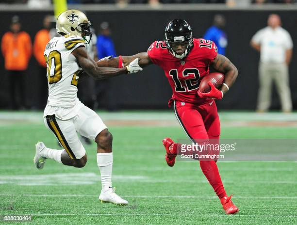 Mohamed Sanu of the Atlanta Falcons tries to escape the tackle attempt by Ken Crawley of the New Orleans Saints at MercedesBenz Stadium on December 7...