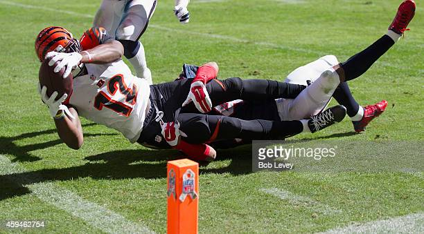 Mohamed Sanu of the Cincinnati Bengals scores in the first quarter as AJ Bouye of the Houston Texans can't make the tackle at NRG Stadium on November...