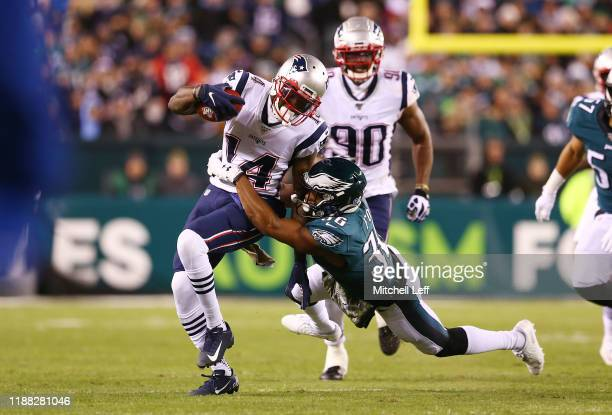 Mohamed Sanu of the New England Patriots is tackled by Rudy Ford of the Philadelphia Eagles during the first half at Lincoln Financial Field on...