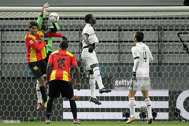 Mohamed Saqr of AlSadd attempts to catch the ball against Ousama Darragi of Esperance Sportive de Tunis during the FIFA Club World Cup Quarter Final...