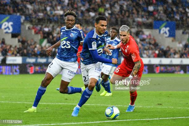 Mohamed SIMAKAN of Strasbourg Kenny LALA of Strasbourg and Mihailo RISTIC of Montpellier during the Ligue 1 match between Strasbourg and Montpellier...
