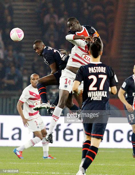 Mohamed Sissoko and Mamadou Sakho of Paris SaintGermain fight for the ball during the French Ligue 1 between Paris SaintGermain and FC Girondins de...