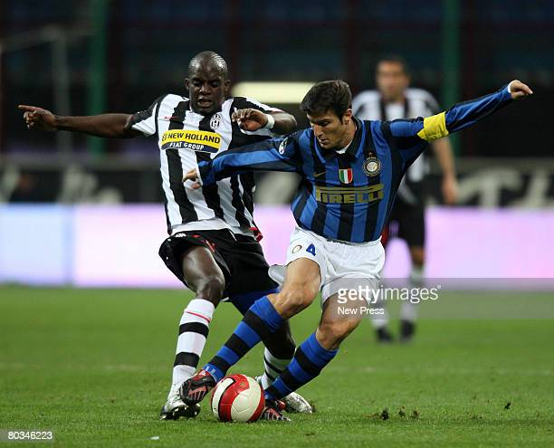 Mohamed Sissoko of Juventus and Javier Zanetti in action during the Serie A match between Inter Milan and Juventus at the Giuseppe Meazza stadium on...