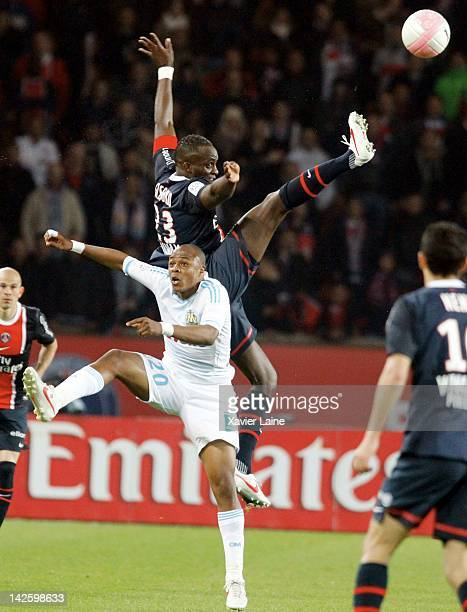 Mohamed Sissoko of Paris SaintGermain and Andre Ayew of Olympique de Marseille compete for the ball during the French Ligue 1 between Paris...