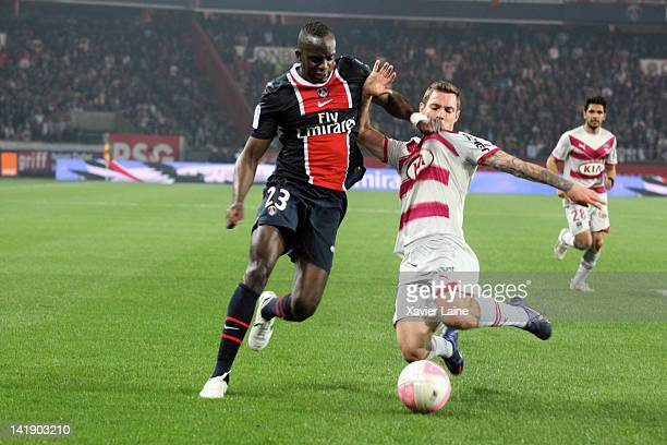 Mohamed Sissoko of Paris SaintGermain and Ludovic Obraniak of Bordeaux in action during the French Ligue 1 between Paris SaintGermain and FC...