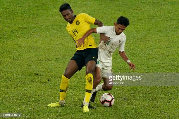 Mohamed Syamer Kutty of Malaysia battles Teuku Muhammad Ichsan of Indonesia during the 2022 Qatar FIFA World Cup Asian qualifier group G match...