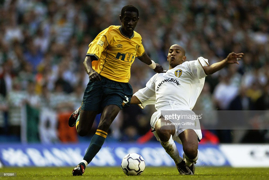 Mohamed Sylla of Celtic takes the ball past Olivier Dacourt of Leeds United during the Gary Kelly Testimonial match played at Elland Road, in Leeds, England on May 7, 2002. Celtic won the match 4-1. DIGITAL