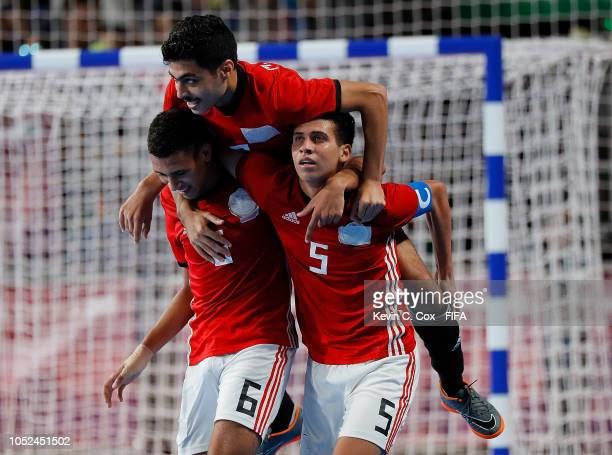 Mohamed Talaat of Egypt celebrates scoring the fifth goal against Argentina with Mohamed Morsy and Mohamed Ahmed in the Men's Futsal 3rd Place match...