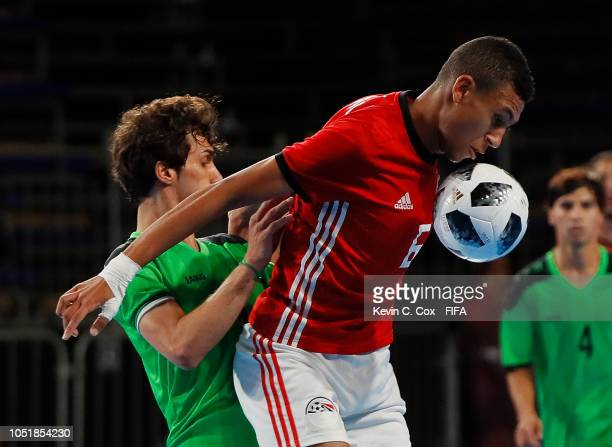 Mohamed Talaat of Egypt is challenged by Hadi Alaa of Iraq in the Men's Group A match between Iraq and Egypt during the Buenos Aires Youth Olympics...